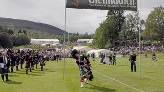 Mace Throw Banner challenge for the Drum Majors during the 2018 Braemar Gathering Highland Games