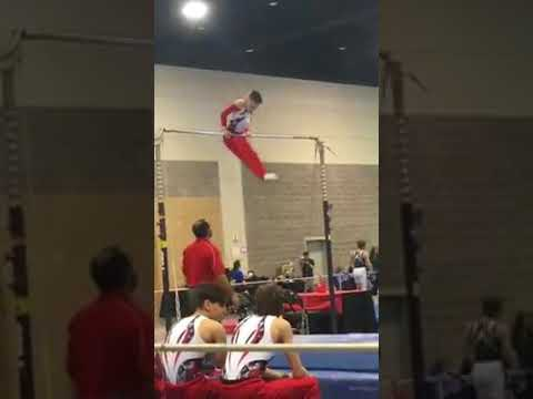 Coach Cal Booker makes amazing catch after gymnast Noah Viera loses grip of high bar in Springfield
