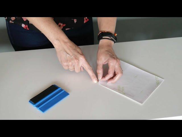 Tip om een sticker van het achtervel af te halen
