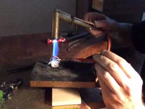 Making jewelry / soldering with gasoline .