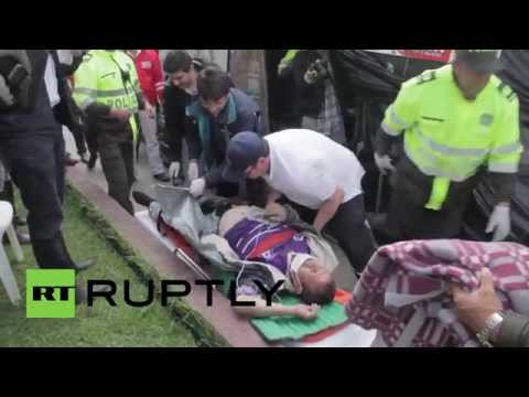 Colombia: Ex-General Motors workers bury themselves alive outside US embassy