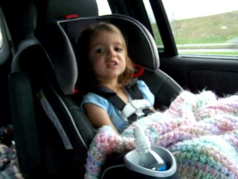 4 year old in her car seat singing Taylor Swift's