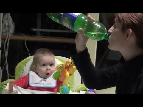 Baby's mind gets totally blown while watching mom drink