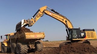 cat 352f excavator loading volvo a30g dumpers with 1 meter wide lgp tires