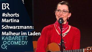 Martina Schwarzmann beim Herrenausstatter