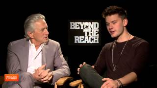 Exclusive Interview: Michael Douglas and Jeremy Irvine Talk Beyond The Reach [HD]