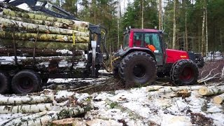 Valtra 6850 forestry tractor logging in winter forest