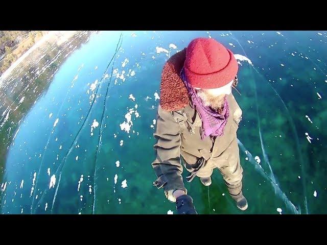 Russian man films mesmerizing walk across world's deepest frozen lake