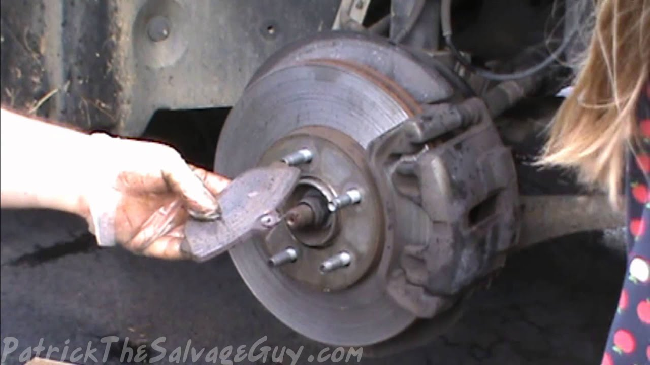 replace front brake pads    ford taurus