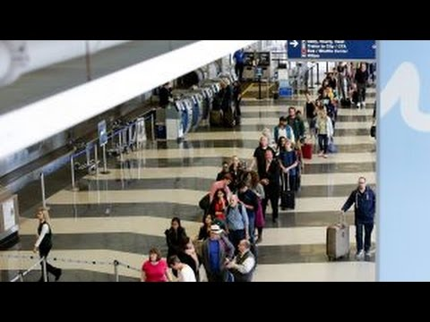 What is causing the massive travel delays at airports?