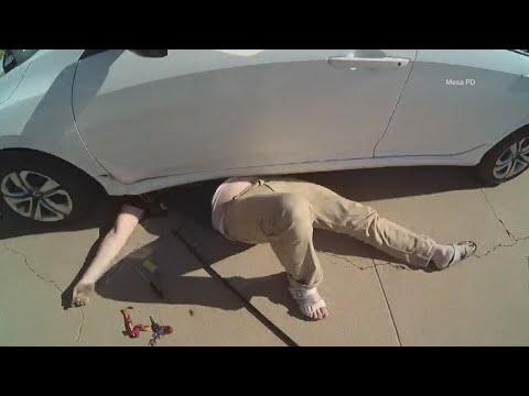 Caught on camera: Arizona cops lift car off trapped man