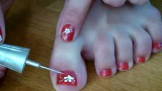 Bright red pedicure with white camomiles