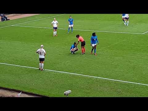 Alex Greenwood kicks ball at Brazil player