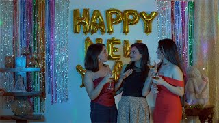 Young girlfriends talking and clinking wine/champagne glasses during New year in India