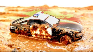 Dirty police toy cars race through the mud and go to the car wash