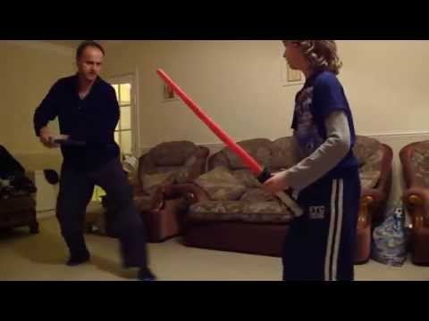 light sabre battle between father and son  ( choreographed )