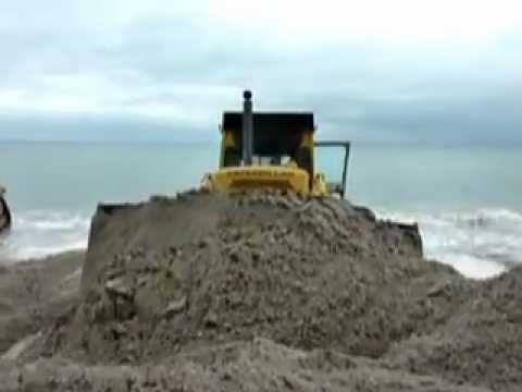With estimated 13-15 foot waves expected to impact Westport during Hurricane Sandy, bulldozers created a sand berm along Compo Beach Sunday.