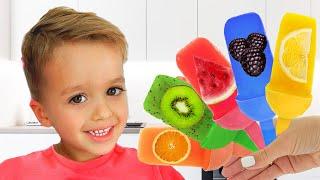 Vlad y Niki fingen jugar cocinar helado de frutas