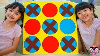 หนูยิ้มหนูแย้ม   เล่นเกม XO กล่องกระดาษ