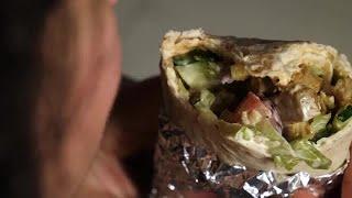 Woman Eats A Kebab Stock Video