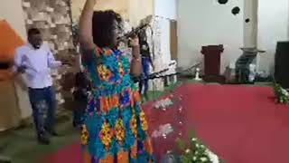 Pastor Medoreen Besa singing at the conference on Day 3