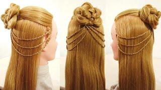 Вариант красивой несложной женской прически из косичек Красивые косички с цветком из волос