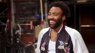 Donald Glover, Beck Bennett Clash Over Dominoes in Goofy 'SNL' Promo