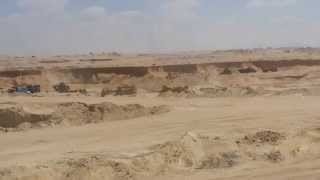Suez Canal new: a scene in the second dig in at noon