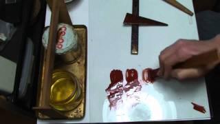 漆刷毛をサラダ油で洗う。 Cleaning a paint brush with cooking oil.