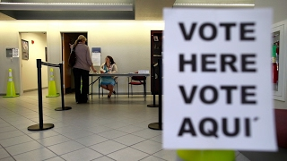 Jailed green card holder who voted could face...