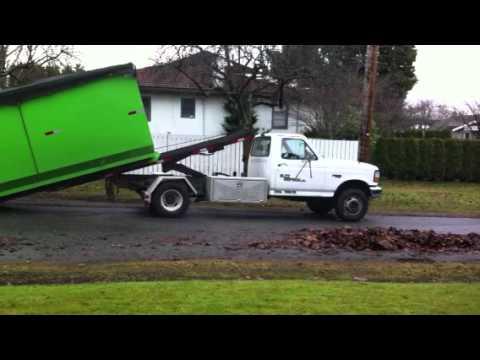 Free Junk Removal >> Blitz Disposal Mini Bin roll off pulling on 20 yards of ...