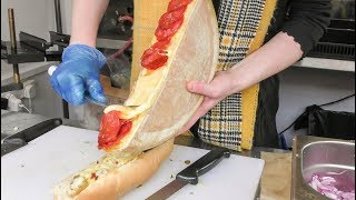 Swiss Raclette. Warm Melted Swiss Cheese with Chorizo Sausage and  Serrano Ham. London Street Food