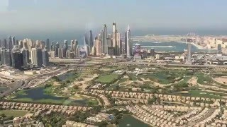 Flying over the New Dubai Marina District overlooking the Palm Jumeirah Island.