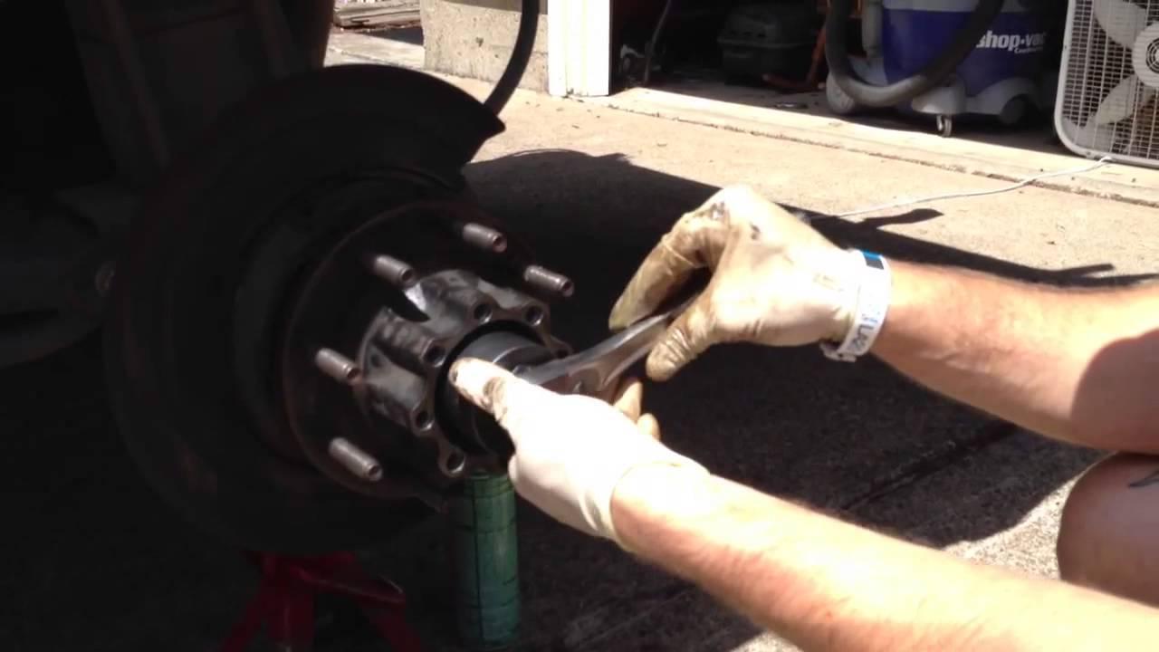 medium resolution of removing rear left axle locking nut