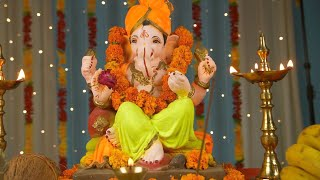 Pan shot of Lord Ganesha Idol for Ganesh Chaturthi - Colorful festive background