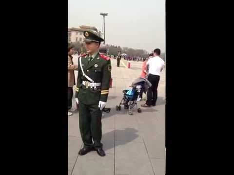 Picture of officers in Beijing turns to be of a kid peeing in a plastic glove
