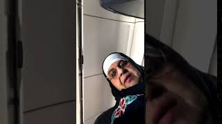 guy films lady looking at his phone screen on airplane