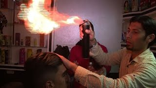 Gaza barber wields flames as business heats up