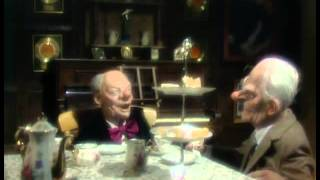 Dear, dear Larry and dear, dear Johnny have tea. Spitting Image sketch
