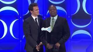 Tituss Burgess and Jonathan Groff present to Sports Illustrated at the #glaadawards