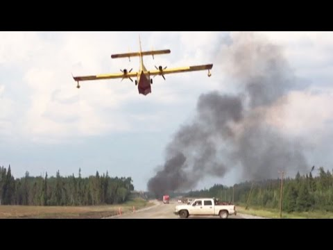 Caught on Cam: Water bomber tackles Manitoba highway blaze