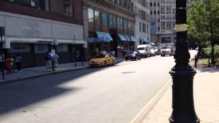 NEW YORK PRESBYTERIAN HOSPITAL EMS AMBULANCE RESPONDING ON PARK ROW IN LOWER MANHATTAN, NEW YORK.