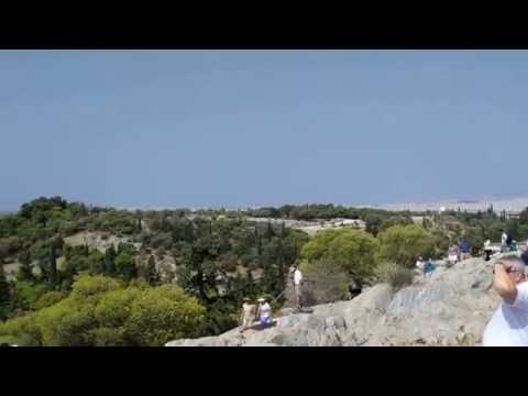 Tourists are filming the view of Athens from Acropolis hill