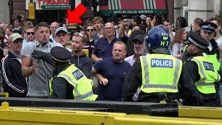 Police FIGHT with protesters in London!