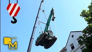 EXCAVATOR FLYING THROUGH THE AIR! SPECTACULAR ACTION WITH CRANE - MUST SEE