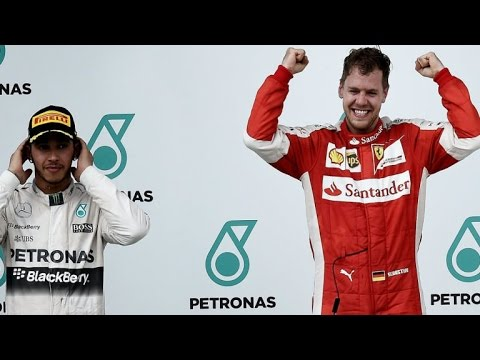 Sebastian Vettel beats Lewis Hamilton to claim first win for Ferrari