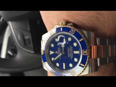 Rolex Submariner 116613LB blue dial two tone bracelet swiss made luxury watch shining on wrist