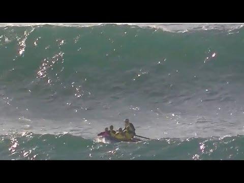 Extreme surfboat rowing in lifesaver relay Kurrawa Beach 2011