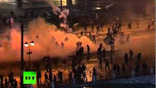 Greece riots: Athens burns, police fire tear gas as violence flares up(Read more http://on.rt.com/7zw385 The worst riot damage in years has struck Athens as MPs pass harsh new austerity measures. Dozens of historic buildings ..., 2012-02-13T08:00:43.000Z)