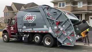 Suburban Freightliner McNeilus RL Garbage Truck